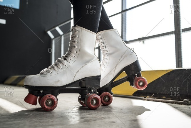 Person wearing retro white roller skates