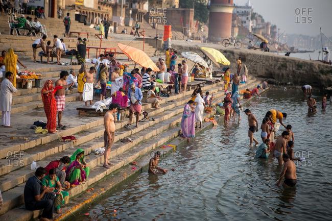 Varanasi, India - April 8, 2015: Crowds along holy Ganges river