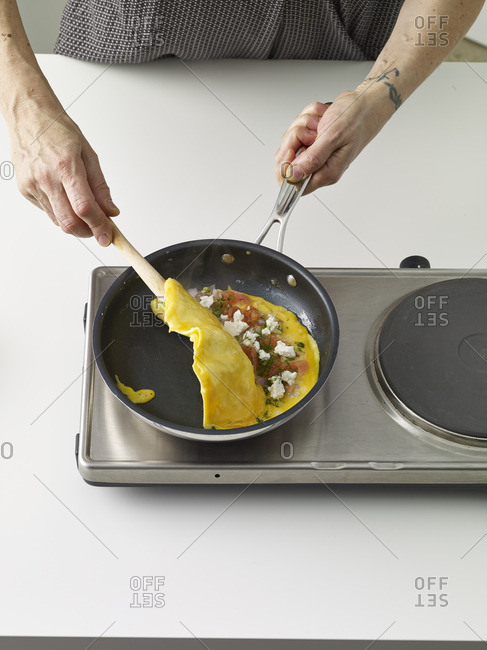 Cook flipping an omelet