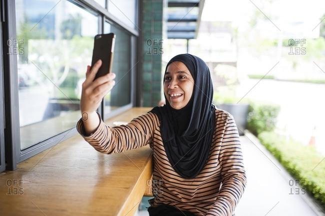 Woman taking a selfie in Malaysia