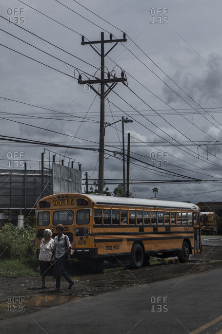Rincon de la Vieja, Costa Rica, Central America - August 28, 2014: Women walking in front of a local bus