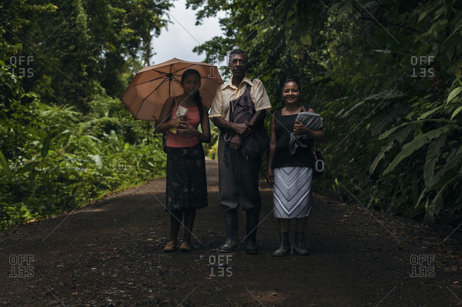 Peninsula de Osa, Costa Rica, Central America - August 16, 2014: A family walking under the sun in the forest