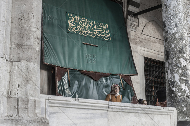 Istanbul, Turkey, Middle east - January 5, 2015: Woman on a balcony in the mosque