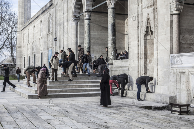 People going out from the mosque after praying