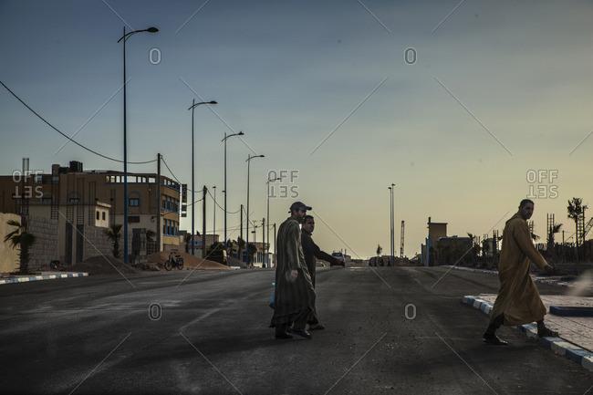 Tarfaya, Morocco, Africa - December 28, 2015: People crossing the street