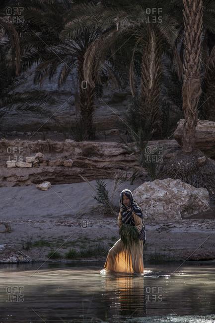 Akka, Morocco, Africa - December 30, 2015: Woman in the lagoon
