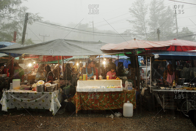 Koh Tao, Thailand, Asia - January 26, 2011: Local market under the rain