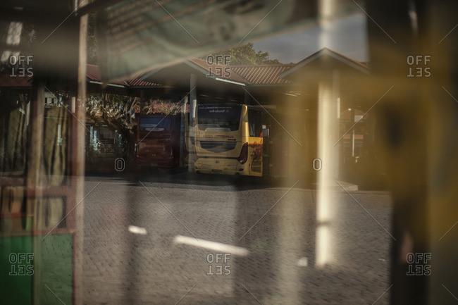 Mataram, Lombok, Indonesia - August 19, 2016: Reflection of the bus station in Mataram