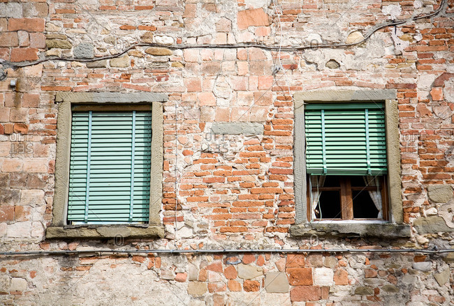Windows and terracotta brick wall