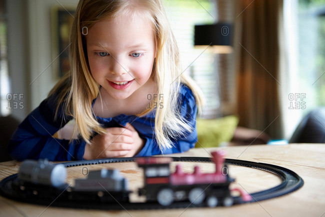 Girl playing with toy train