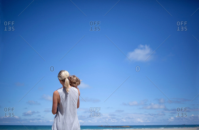 Woman and son on the beach