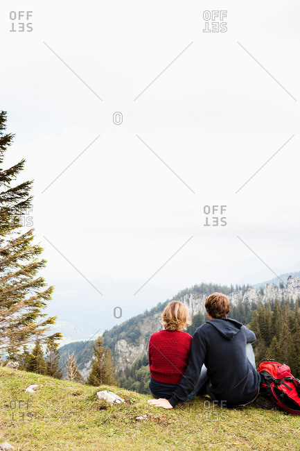 Couple resting on mountain