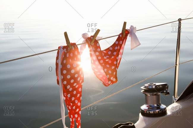 Bikini hanging on rail
