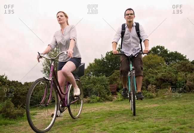 Couple bicycle over heath