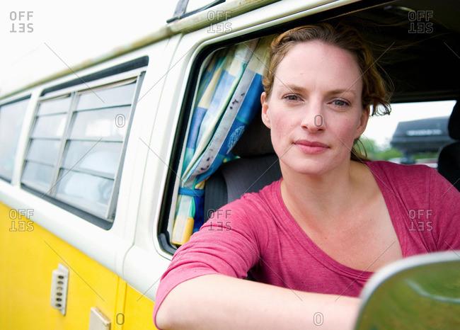 Women at the wheel of a camper van