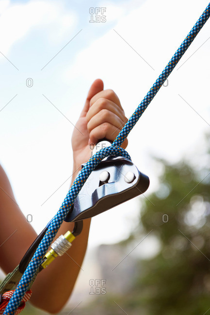 Closeup of a climber's hand and rope