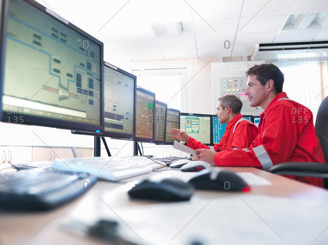 Workers in control room of gas plant