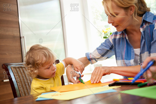 Woman doing handicraft with child