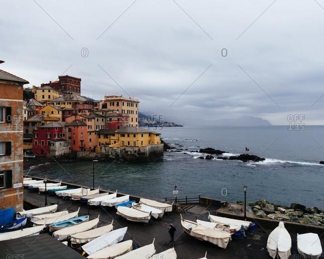 Genoa, Italy - November 23, 2014: Buildings and boats along the coastline of Genoa, Italy