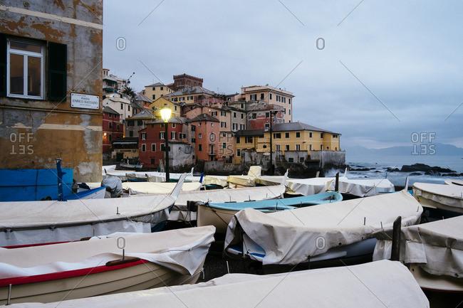 Genoa, Italy - November 23, 2014: Buildings and boats along the coast of Genoa, Italy