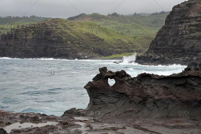 Natural heart shape in the basalt rock along the coast of western Maui, Hawaii
