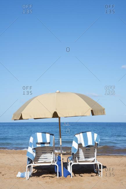 Beach chairs and umbrella along the beach in Wailea, Maui, Hawaii