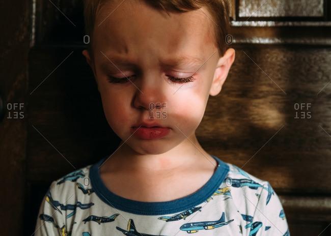 Close-up portrait of an upset little boy