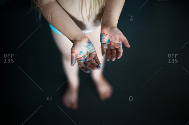 Child's paint-spotted hands - Offset Collection