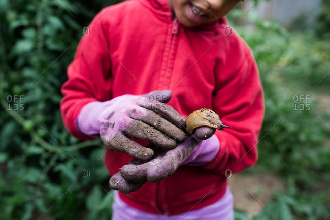 Child holding a giant garden slug