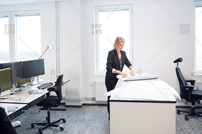 Mature architect working in office