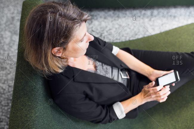 Architect texting on smart phone