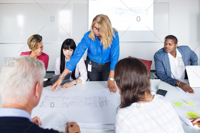 Team of architects and project managers working in office