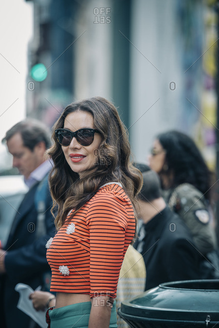 New York City, New York - February 22, 2016: Beautiful lady with sunglasses on 5th Avenue