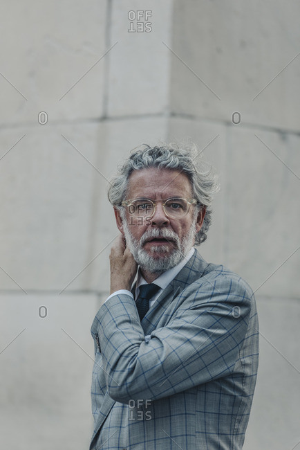 New York City, New York - February 22, 2016: Man in suit with glasses