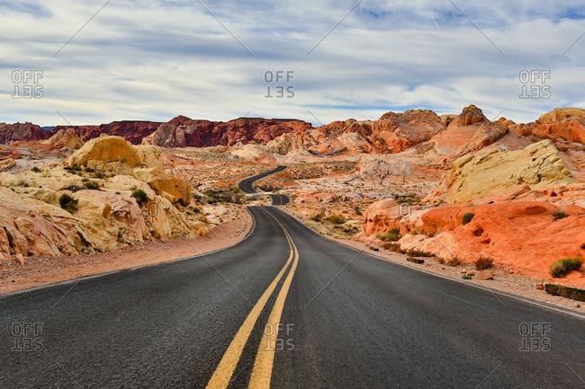 Highway in through desert mountains