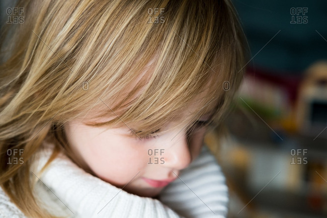 Close up of a little girl with dark blond hair