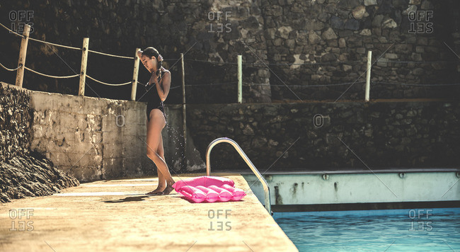 Woman wringing the water from her hair after swimming