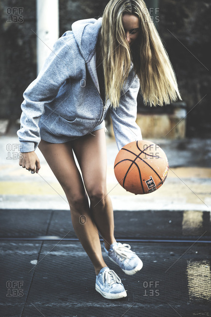 Woman dribbling a basketball
