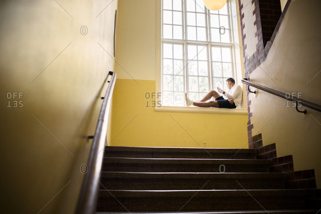 Student sitting by window