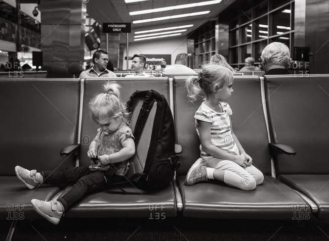 September 23, 2016: Two girls waiting in an airport