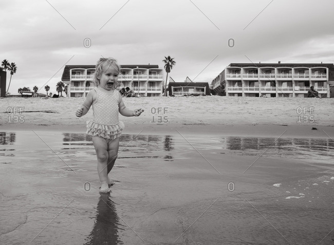 Delighted toddler on a beach
