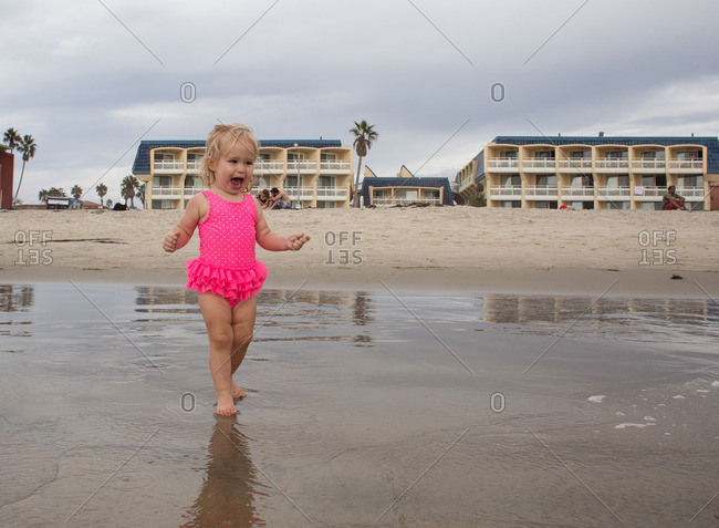Delighted toddler on sea shore