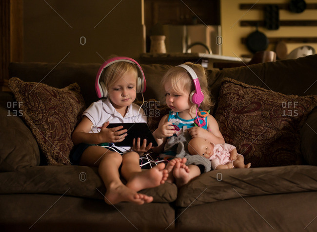 Girls watching tablet together on couch