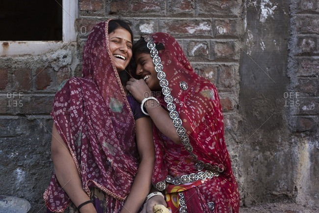 Bisalpur, Uttar Pradesh, India - February 16, 2015: Mid-adult women laughing, Bisalpur, Uttar Pradesh, India
