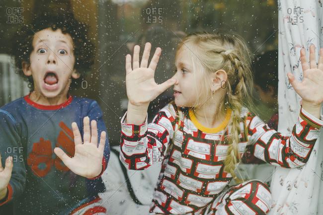 Girl watching boy make goofy face