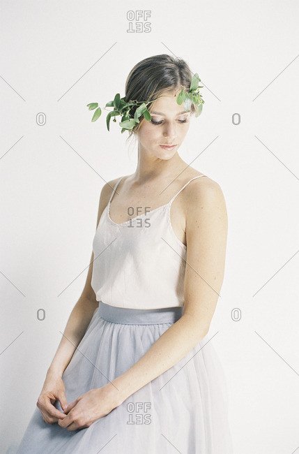 Woman in tulle skirt wearing floral crown
