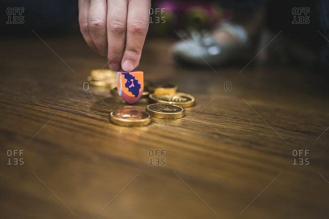 Hand of a man getting ready to spin a dreidel
