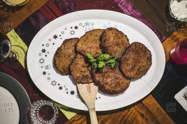 Platter of cooked latkes on a table