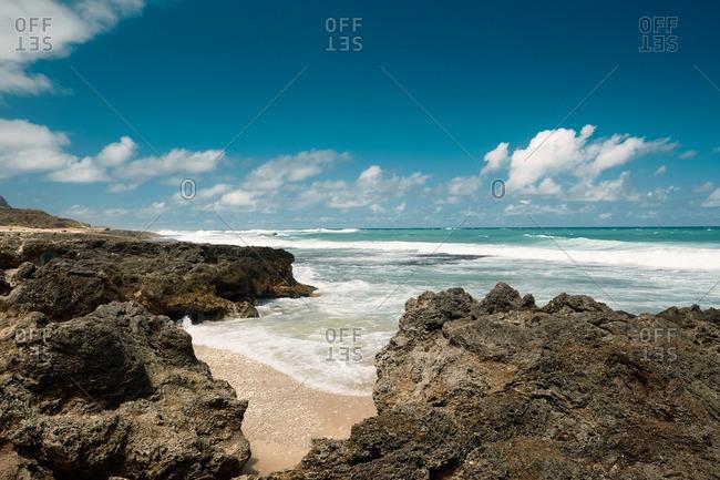 Volcanic rocks on beach in Hawaii