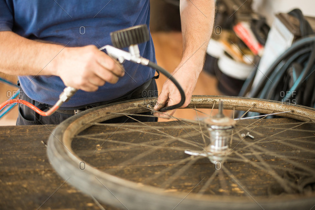 Man inflating bicycle tire